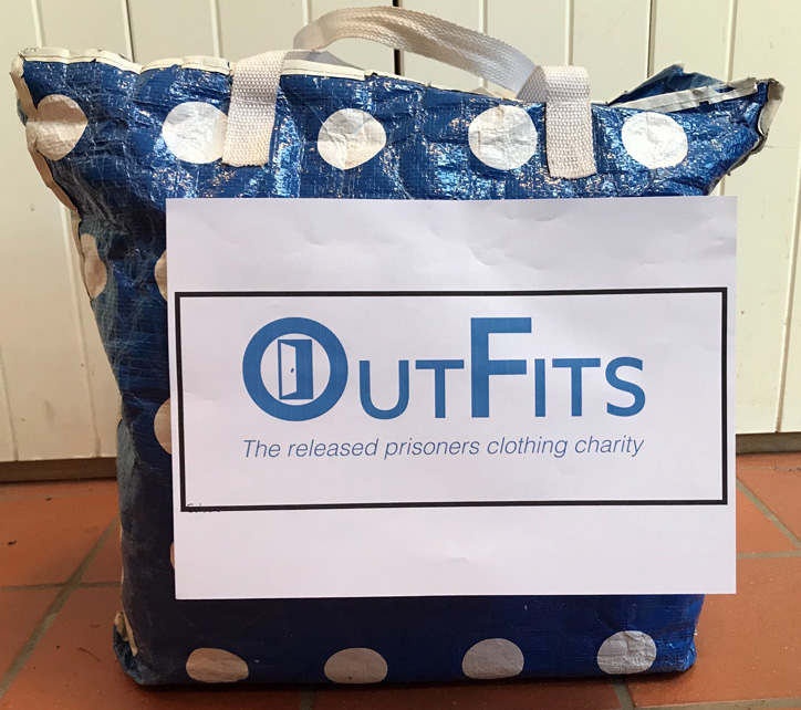Blue bag with white spots with OutFits label affixed