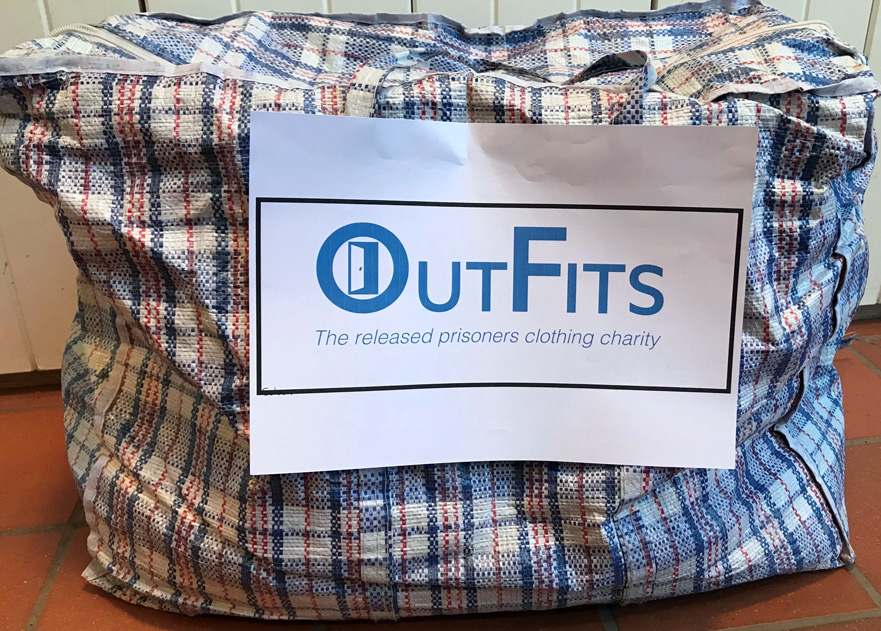 Checked laundry bag with OutFits label affixed